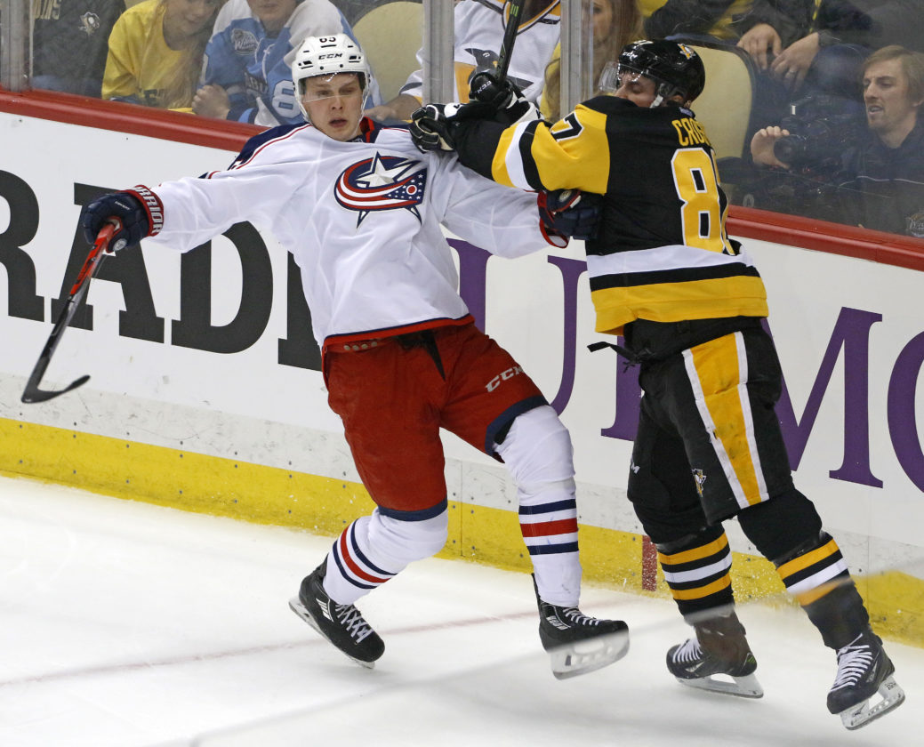 Pittsburgh Penguins' Sidney Crosby (87) checks Columbus Blue Jackets' Markus Nutivaara (65) during the first period in Game 5 of an NHL first-round hockey playoff series in Pittsburgh, Thursday, April 20, 2017. (AP Photo/Gene J. Puskar)
