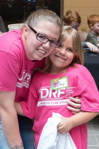 Chevy Pyles of Moundsville, a patient of Dr. Amy Jean, poses with her mother, Nikita Holt, at the 2015 Juvenile     Diabetes Research Fund Walk.