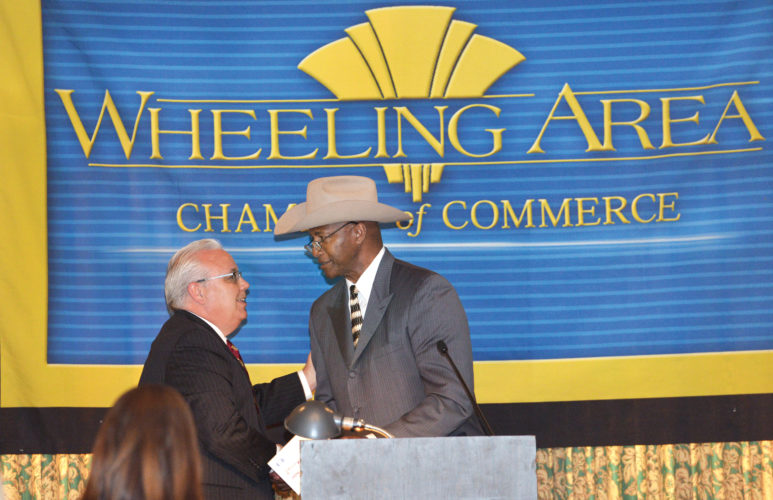 Wheeling Area  Chamber of Commerce Executive Committee member John Culler, left, introduces former  Pittsburgh  Steeler and Pro Football Hall of Fame member Mel Blount.