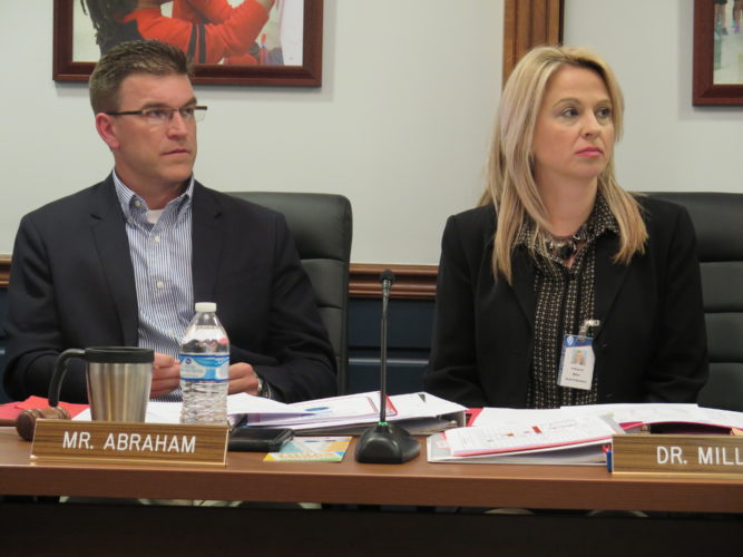 Photo by Joselyn King Ohio County Schools Board of Education President Zach Abraham, left, and Superintendent Kim Miller listen to discussion during Thursday night's board meeting.