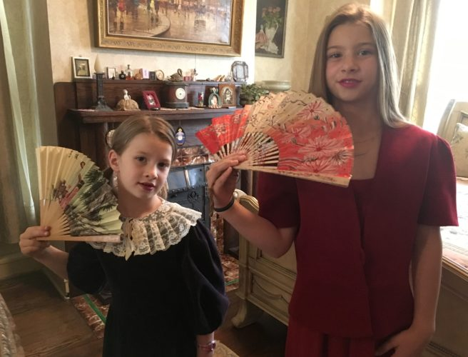 Photo Provided The writer's granddaughters enjoy dressing up and carrying her mother's antique fans, from left Sophia and Margaret Mary Benson.