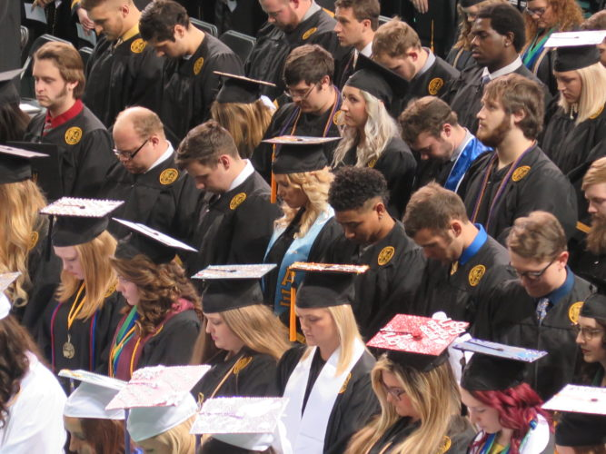 Photo by Alec Berry Heads are bowed as the 180th commencement ceremony begins at West Liberty University on Saturday.