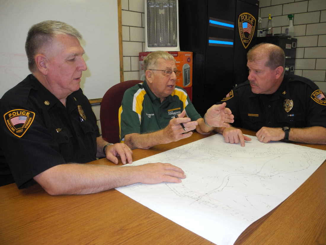 "Photo by Ian Hicks Meeting to discuss plans for the Ogden Newspapers Half Marathon Classic on May 27, from left, are Wheeling Deputy Police Chief Martin Kimball, Race Director R. ""Scat"" Scatterday and Police Chief Shawn Schwertfeger."