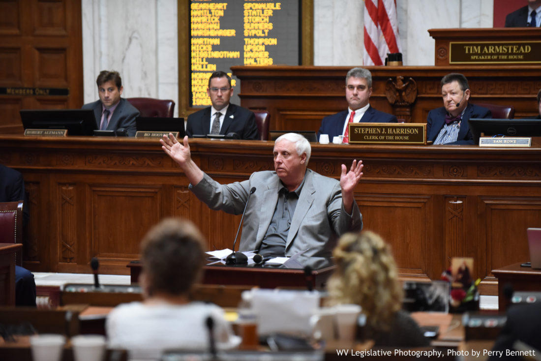 Photo by Perry Bennett, W.Va. Legislature West Virginia Gov. Jim Justice addresses House of Delegates members Wednesday.