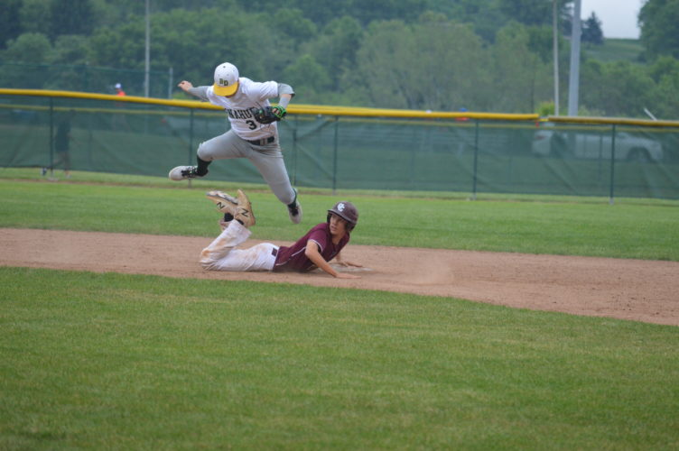 Wheeling Central's Caleb Custer, bottom, slides in safely to second as Bishop  Donahue's Nate Rush goes up to make a catch during Wednesday's Class A, Region One, Section One Final.   Photo by  Cody Tomer