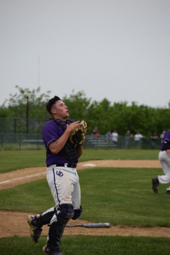 Photo by Seth Staskey Martins Ferry catcher Connor Pollock makes a catch in foul territory against Edison.