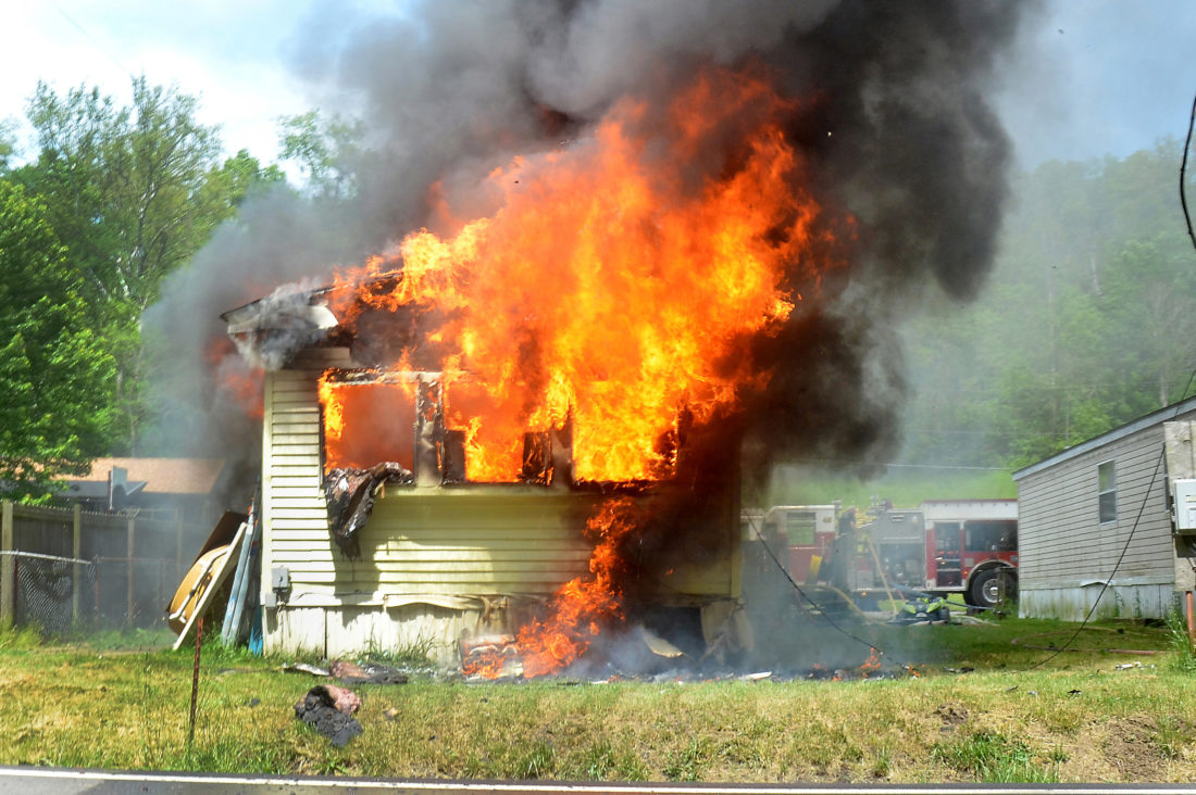 Photos by Scott McCloskey Firefighters from at least five area volunteer fire departments battle a blaze at the Meadowlands II trailer court off of GC&P Road near Boone and Hedges Road in Ohio County Thursday afternoon.