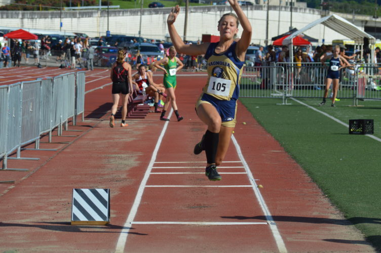 Photo by Kyle Lutz / Magnolia's Bailey Estep leaps into the air during the long jump portion of the W.Va. State Track Meet. She won the event.