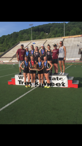 The Wheeling Central girls' track team, led by Coach Eric Belancic, top left, poses with its hardware after winning the West Virginia Class A state championship Saturday in Charleston.