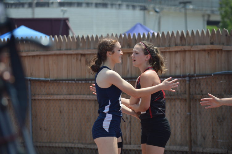 Madonna's Lea Colantonio and Union's Collena Burdock congratulate each other after the 100-meter final during the state meet. Colantonio won the event.