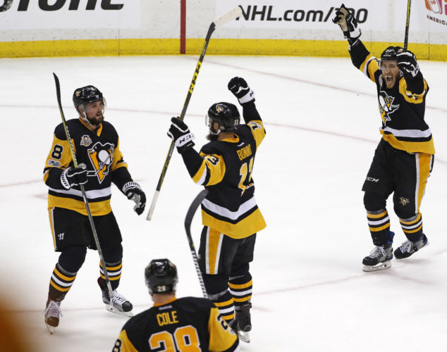 Pittsburgh Penguins' Nick Bonino, center, celebrates his goal during the first period of Game 5 of the Eastern Conference final in the NHL Stanley Cup hockey playoffs in Pittsburgh, Sunday, May 21, 2017. (AP Photo/Gene J. Puskar)
