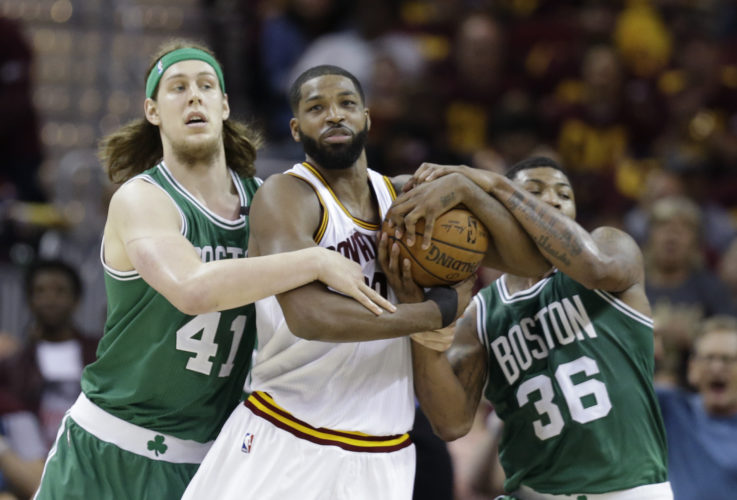 Cleveland Cavaliers' Tristan Thompson (13) battles Boston Celtics' Kelly Olynyk (41) and Marcus Smart (36) for a rebound during the first half of Game 3 of the NBA basketball Eastern Conference finals, Sunday, May 21, 2017, in Cleveland. (AP Photo/Tony Dejak)