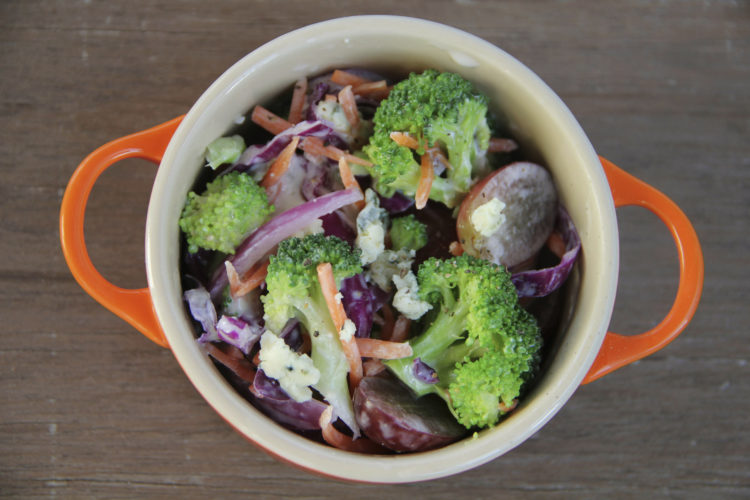 This May, 13, 2017 photo shows a broccoli and blue cheese salad in Coronado, Calif. This dish is from a recipe by Melissa d'Arabian. (Melissa d'Arabian via AP)