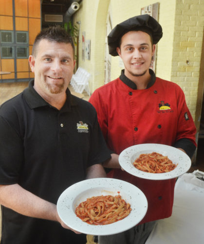 Photo by Scott McCloskey River City Restaurant co-owner Jason Miller, left, and Chef David McCardle display the pasta marinara that will be included on the restaurant's buffet available for Ogden Newspapers Half Marathon Classic participants this weekend.