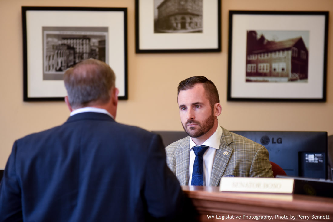 Photo by Perry Bennett, W.Va. Legislature West Virginia Senate Majority Leader Ryan Ferns, R-Ohio, speaks with Sen. Ed Gaunch, R-Kanawha, before a Senate Select Committee on Tax Reform meeting Monday at the Capitol.