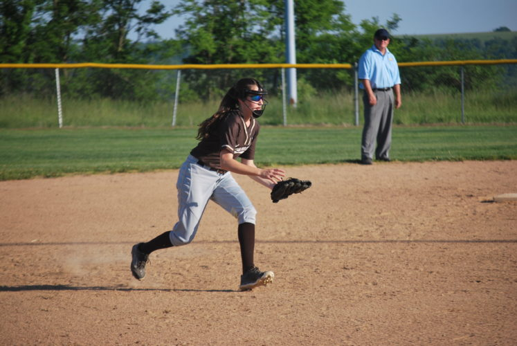 John Marshall's Lydia Knutsen fields a grounder during the regional finals against Morgantown.