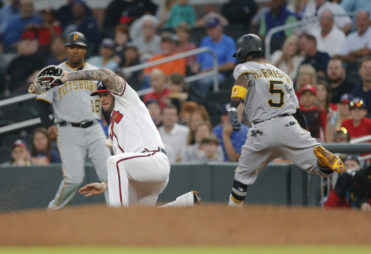 Pittsburgh Pirates third baseman Josh Harrison (5) reaches first base with an RBI-base hit in as Atlanta Braves first baseman Matt Adams (18) handles the throw the third inning inning of a baseball game, Monday, May 22, 2017, in Atlanta. (AP Photo/John Bazemore)