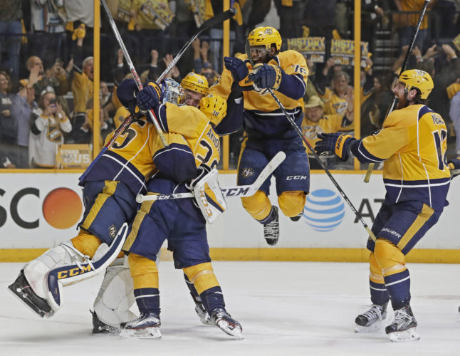 Nashville Predators players including defenseman P.K. Subban, second from right, celebrate with goalie Pekka Rinne, of Finland, left, after winning Game 6 of the Western Conference final against the Anaheim Ducks in the NHL hockey Stanley Cup playoffs Monday, May 22, 2017, in Nashville, Tenn. (AP Photo/Mark Humphrey)