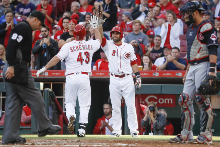 Cincinnati Reds' Scott Schebler (43) celebrates with Jose Peraza (9) after hitting a solo home run off Cleveland Indians starting pitcher Josh Tomlin in the second inning of a baseball game, Monday, May 22, 2017, in Cincinnati. (AP Photo/John Minchillo)