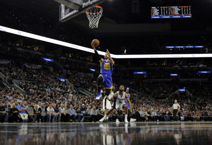 Golden State Warriors guard Stephen Curry (30) goes up for a shot after getting past San Antonio Spurs' Patty Mills, center bottom, during the first half in Game 4 of the NBA basketball Western Conference finals, Monday, May 22, 2017, in San Antonio. (AP Photo/Eric Gay)