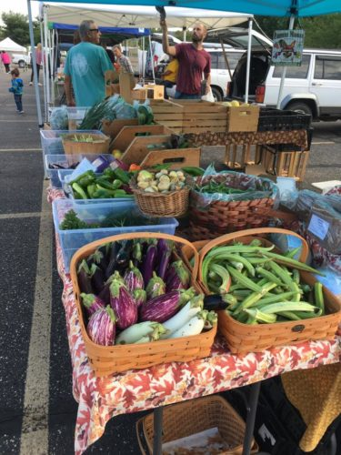 Above, produce from Lone Oak Farms is among the offerings at the Ohio Valley Farmers' Market. New vendors this year include Kelly McGinley (produce), Meredith's Pop Shop (cake pops), Yardscape LLC (lawn ornaments) and Rustic Kneads (breads).