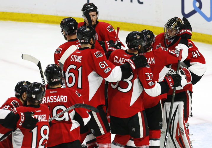 The Ottawa Senators celebrate their victory over the Pittsburgh Penguins in game six of the Eastern Conference final in the NHL Stanley Cup hockey playoffs in Ottawa on Tuesday, May 23, 2017. (Fred Chartrand/The Canadian Press via AP)