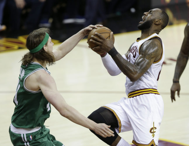 Boston Celtics' Kelly Olynyk (41) defends against Cleveland Cavaliers' LeBron James (23) during the second half of Game 4 of the NBA basketball Eastern Conference finals, Tuesday, May 23, 2017, in Cleveland. The Cavaliers won 112-99. (AP Photo/Tony Dejak)