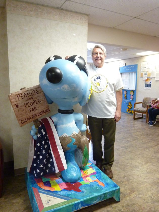 """Photo by Linda Comins """"Joe Too Cool to Smoke"""" Snoopy marks its 10th birthday with Ohio County health officer Dr. William Mercer, who uses the character as an anti-smoking educational tool. Mercer is wearing a """"Joe Too Cool to Smoke"""" T-shirt given to students. When not making appearances, """"Joe Too Cool to Smoke"""" Snoopy lives in the lobby of Mercer's private practice office at Wheeling Clinic."""