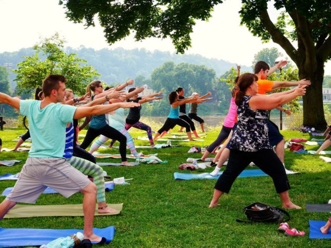 Local residents participate in Yoga on the Lawn at     Wheeling       Heritage Port in downtown Wheeling in 2015. The free, public event was made possible by an Active Trails grant from the National Park Foundation. The Wheeling    National         Heritage Area recently received another Active Trails grant for 2017.  Photo Provided