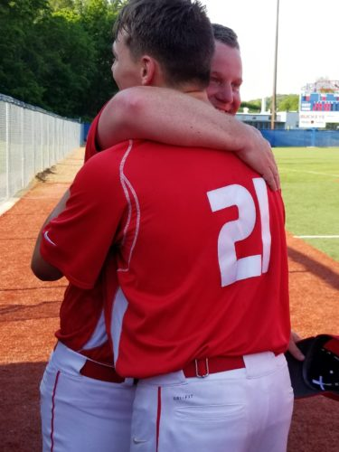 Photo by Rick Thorp Toronto coach Brian Perkins hugs Sante Carducci after the Red Knights advanced to the Ohio Division IV state tournament with an 11-1 victory against Waterford.