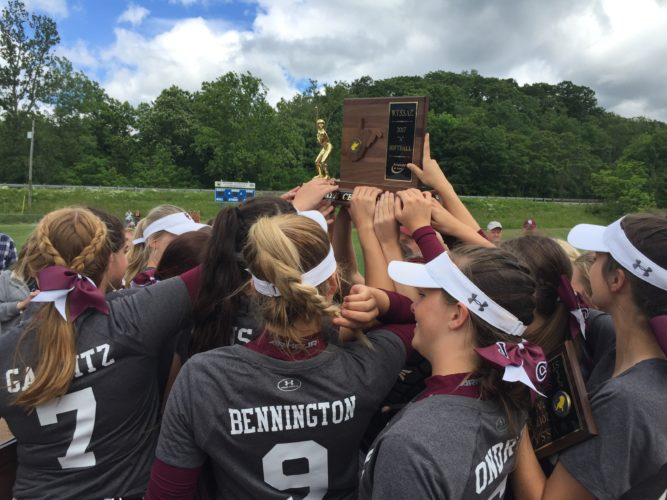 Photo by Josh Strope Wheeling Central softball players raise the state championship trophy Thursday in Vienna.