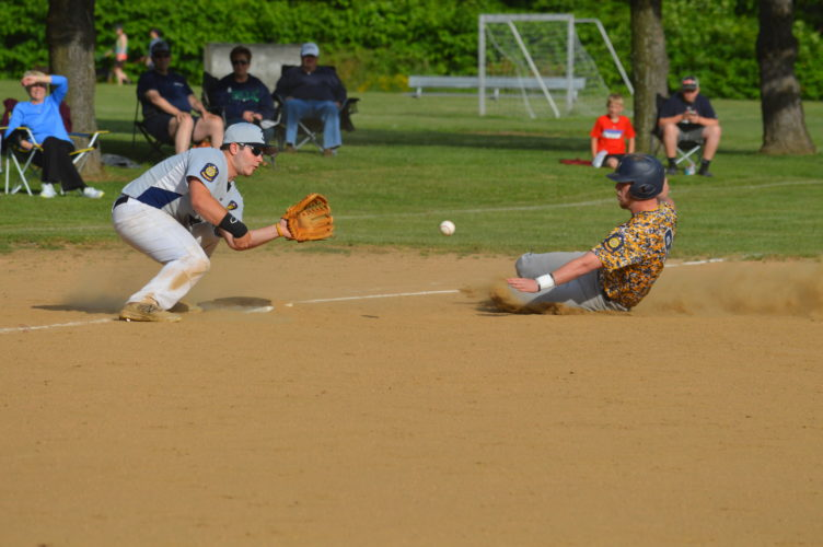 Cody Tomer Wheeling's Chad Harper slides in safely to third as Moundsville's Steve Bailey takes the throw during legion baseball action on Thursday.