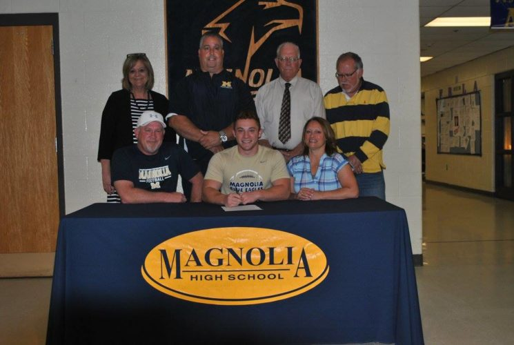 "Flanked by his parents Chad and Stacey, Magnolia's Chase Street recently signed his letter of intent to further his academic (pre-medicine) as well as his athletic talents to West Liberty to play collegiate football. On hand to watch Chase to sign his letter of intent is from standing left are, MHS principal Kathi Schmaltz,  football coach Dave ""Doc"" Chapman, former head coach and current assistant principal Mark Batton and athletics director Brian Castilow."