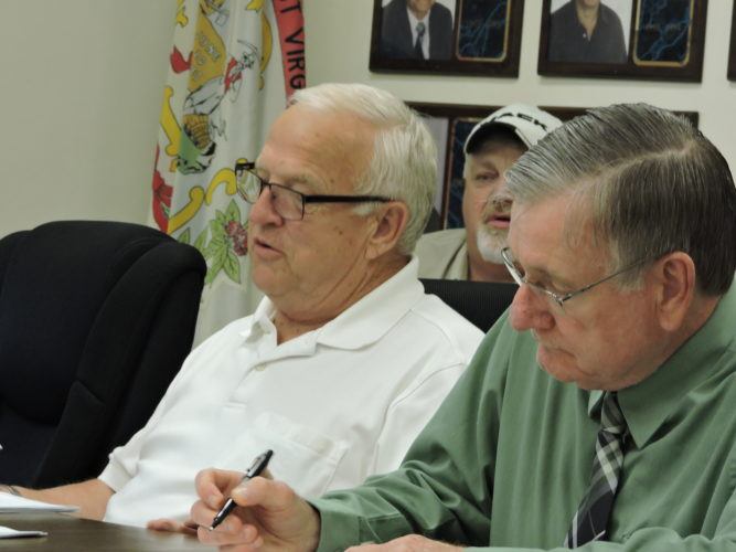 Photo by Alan Olson Moundsville City Councilman David Haynes, left, and Vice Mayor David Wood listen to discussion during a meeting earlier this week.