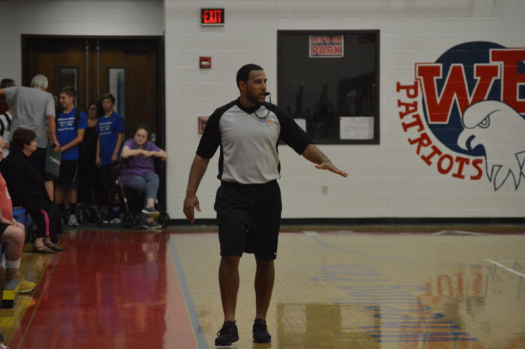 Photo by Cody Tomer Former Ohio Valley Greyhounds quarterback, Jose Davis, runs down the court as a referee during Thursday's summer league game at Wheeling Park.