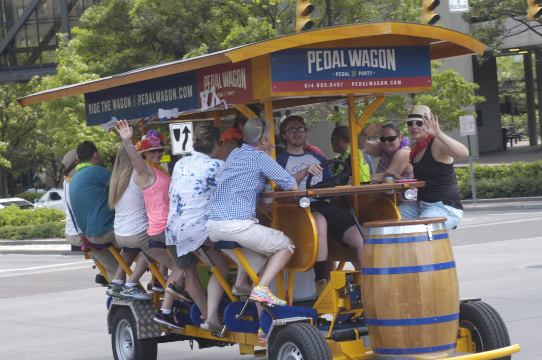 A Pedal Wagon makes its way through downtown Columbus,        powered by beer-drinking patrons.
