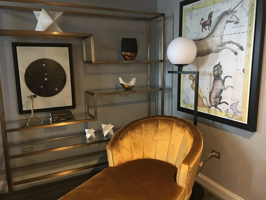 Decor in this Hotel LeVeque room features a large constellation poster print, a        photograph of the Big Dipper, retro objets d'art and a small working telescope.