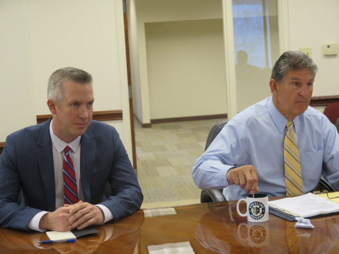 Photo by Joselyn King U.S. Sen. Joe Manchin, D-W.Va., right, and Wheeling Mayor Glenn Elliott attend a roundtable discussion at The Health Plan building in downtown that focused on the future for development in the city.