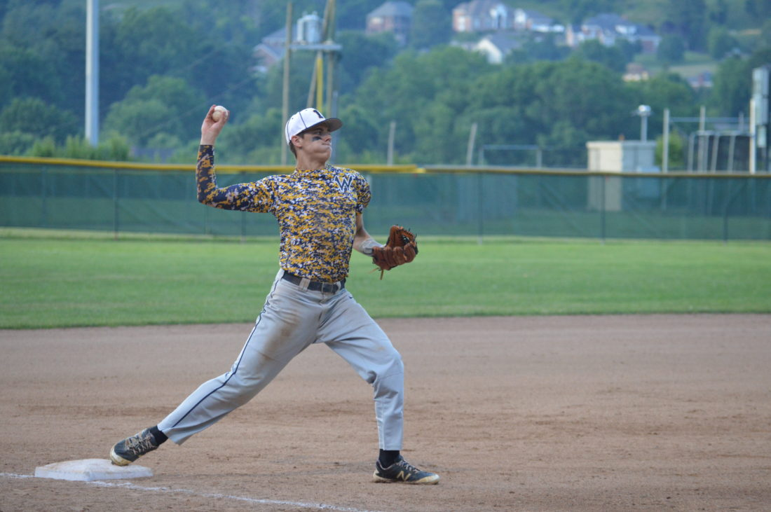 Photo by Cody Tomer. Wheeling's Butter Murray steps on third for a force out and throws to first to complete a double play Saturday at the J.B. Chambers Complex.