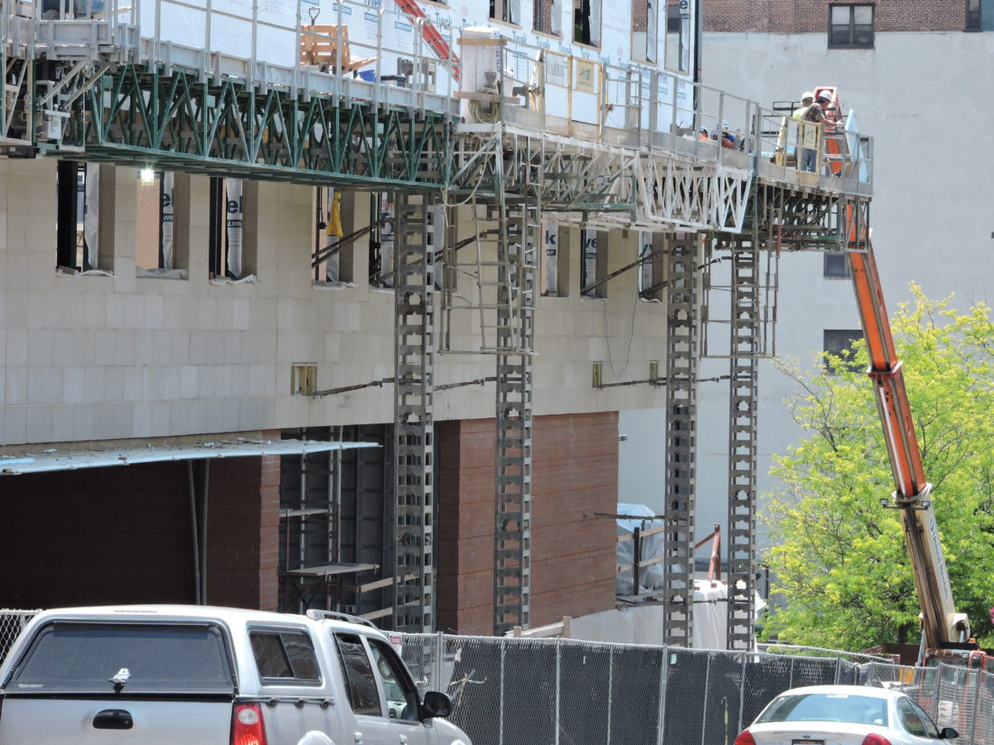 Photo by Casey Junkins Contractors work to complete the new headquarters of The Health Plan in downtown Wheeling.