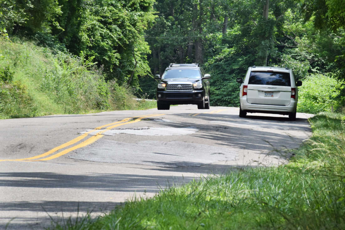 Photo by Scott McCloskey Drivers slowly navigate through the bumps and cracks of Northern Parkway in Wheeling.