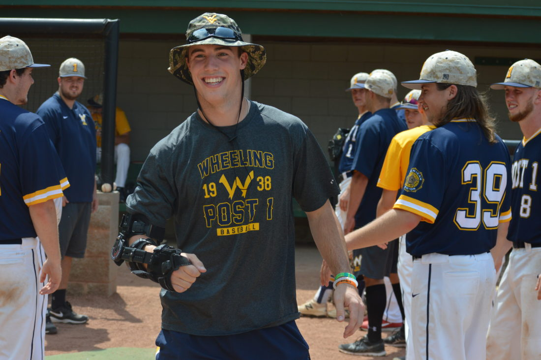 Photo by Cody Tomer Wheeling Post 1 alum and West Virginia University pitcher, Michael Grove, smiles as he is honored during Alumni Day ceremonies Sunday at the J.B. Chambers Complex.