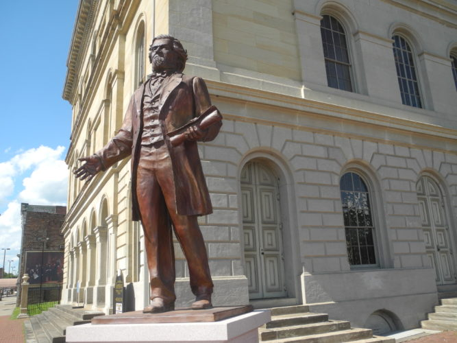 Photo by Ian Hicks The statue of Francis Pierpont, one of the Mountain State's founding fathers, overlooks downtown Wheeling from in front of West Virginia Independence Hall.