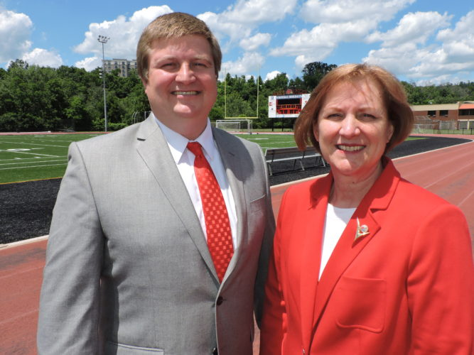 Photo by Casey Junkins Wheeling Jesuit University Athletics Director Kevin Forde and WJU President Debra Townsley announce the addition of a football program at the school Tuesday.