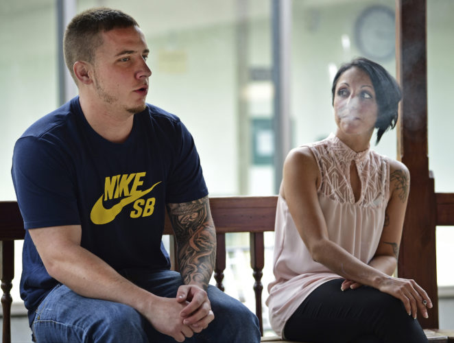 "Paul Wright, left, talks while sitting next to Niki Campana, Thursday, June 15, 2017, at the Neil Kennedy Recovery Clinic in Youngstown, Ohio. Republican efforts to roll back ""Obamacare"" are colliding with the opioid epidemic. Cutbacks would hit hard in states that are deeply affected by the addiction crisis and struggling to turn the corner. The issue is Medicaid, expanded under former President Barack Obama. Data show that Medicaid expansion is paying for a large share of treatment costs in hard hit states.  (AP Photo/David Dermer)"