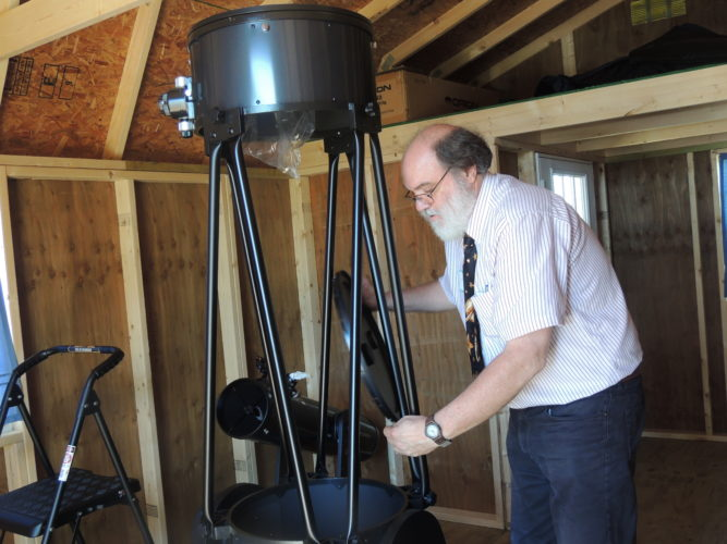Photo by Drew Parker Robert Strong, founder of the Wheeling SMART Center, views a telescope at Grand Vue Park in Moundsville.