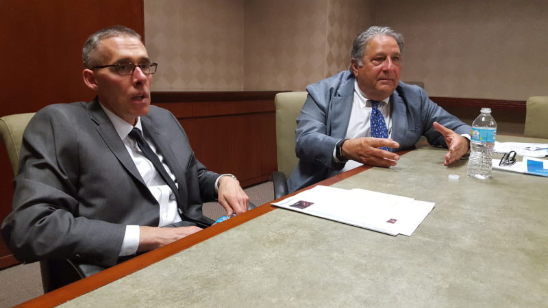 Photo by Paul Giannamore Weirton Medical Center CEO John Frankovitch, left, and Vincent Deluzio, managing director of R&V Associates, the business managing firm at the hospital, speak about the current health care system.