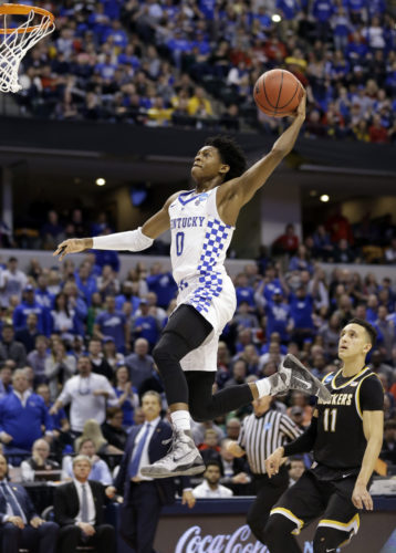FILE - In this March 19, 2017, file photo, Kentucky guard De'Aaron Fox (0) goes up for a dunk in front of Wichita State guard Landry Shamet (11) during the second half of a second-round game in the men's NCAA college basketball tournament,  in Indianapolis. Fox is expected to be a picked at the NBA Draft. (AP Photo/Michael Conroy, File)