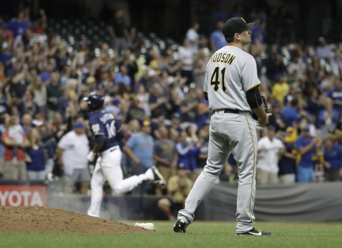 Pittsburgh Pirates' Daniel Hudson reacts after giving up a two-run home run to Milwaukee Brewers' Domingo Santana during the seventh inning of a baseball game Wednesday, June 21, 2017, in Milwaukee. (AP Photo/Morry Gash)