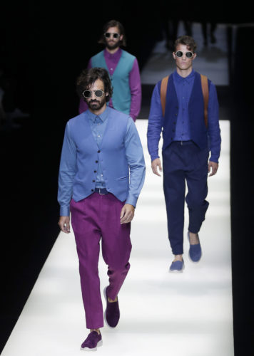 Models wear creations of the Giorgio Armani men's Spring-Summer 2018 collection, part of the Milan Fashion Week, unveiled in Milan, Italy, Monday, June 19, 2017. (AP Photo/Antonio Calanni)